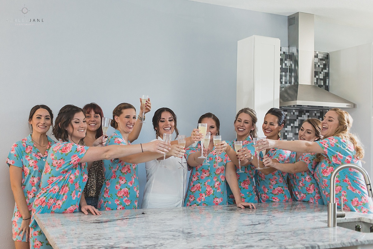 Bride with her bridesmaids in their pj's getting ready