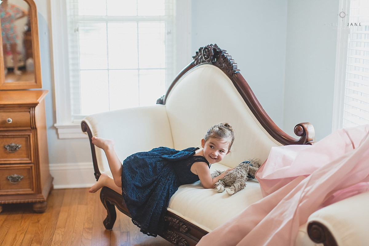 Cute flower girl shot by orlando wedding photographer inside the bridal suite of Cypress Grove Estate House