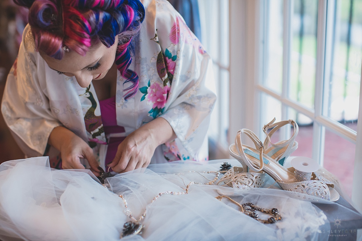 Alternative bride fixing her wedding day details at Luxmore Grande Estate by Orlando Wedding Photographer