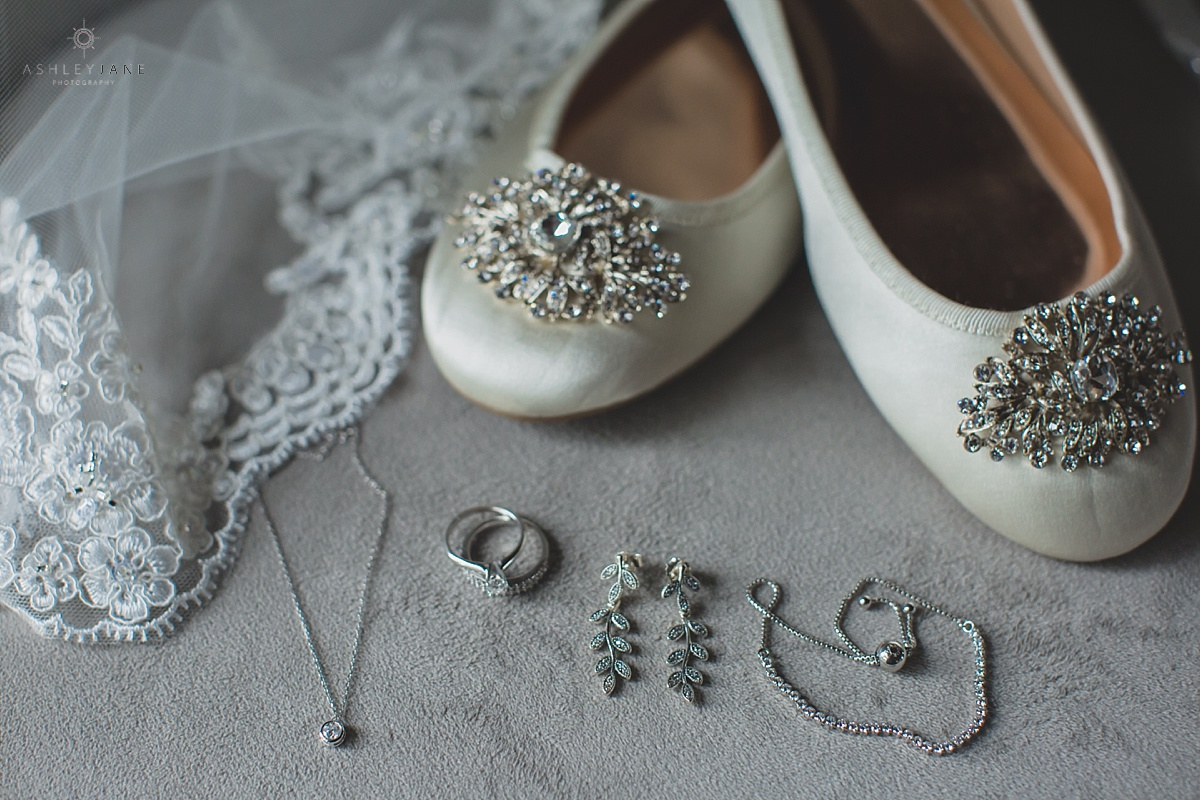 Shot of bride's wedding shoes and accessories caught by orlando wedding photographer