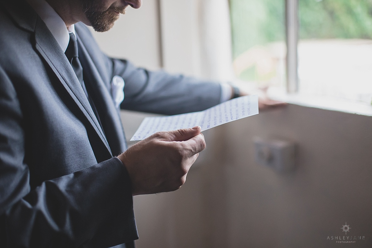 Groom reading a letter from his bride shot by orlando wedding photographer