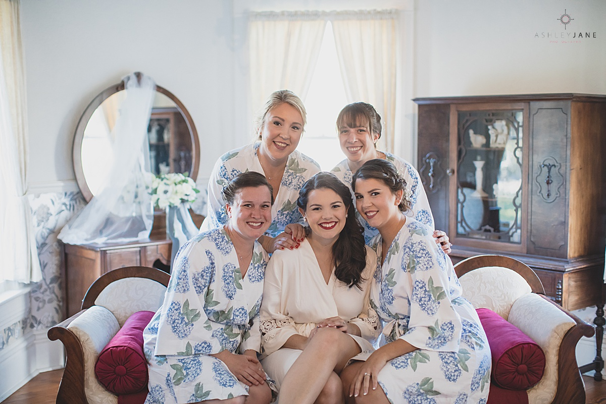 Bride and her bridesmaids in their robes shot by orlando wedding photographer