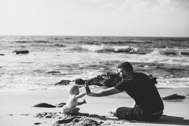 Little girl and dad at beach