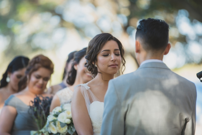 Bride crying tears of joy at the altar at Horizon West Community Church. Shot by Orlando Wedding Photographer