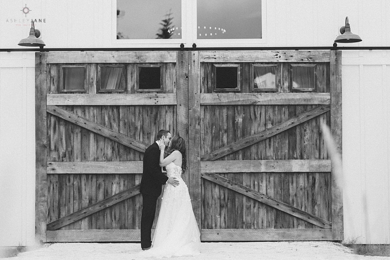 Black and white shot of bride and groom kissing during their first look shot by orlando wedding photographer