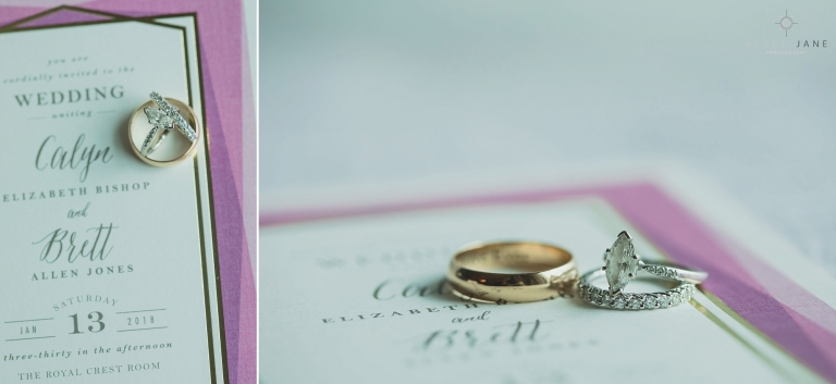 Detail photos of the couple's wedding rings on the wedding invitation. Photo taken by Orlando Wedding Photographer at the Royal Crest Room in St. Cloud.